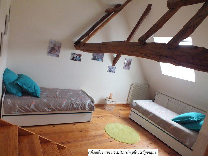 chambre-avec-4-lits-simple–18-
